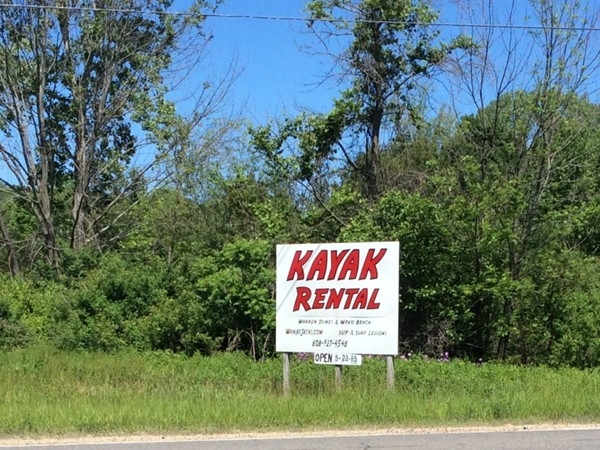Summer is here!  New signs are popping up everywhere like this one for kayak rental at Weco Beach