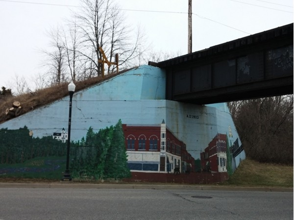 Hand painted train bridge mural