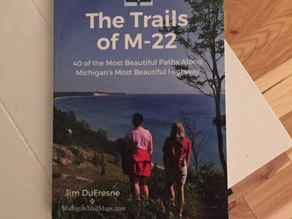 "Go explore! ""The Trails of M-22"" is a handy guide for finding trailheads and distances"