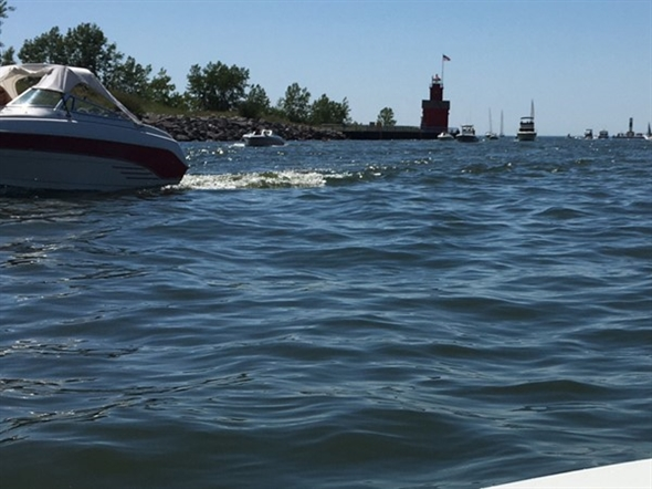 Heading through the channel by boat on Lake Macatawa to Lake Michigan is relaxing