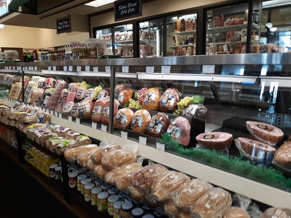Large selection of lunch meat at the deli counter