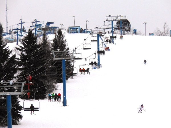Residents taking the chair lift up for a brisk ski down Mt. Holly