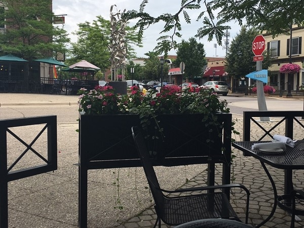 Enjoy a meal on the patio in the Gaslight Village in East Grand Rapids