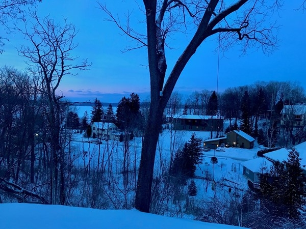 Dusk on a February winter evening. In the distance is Little Traverse Bay