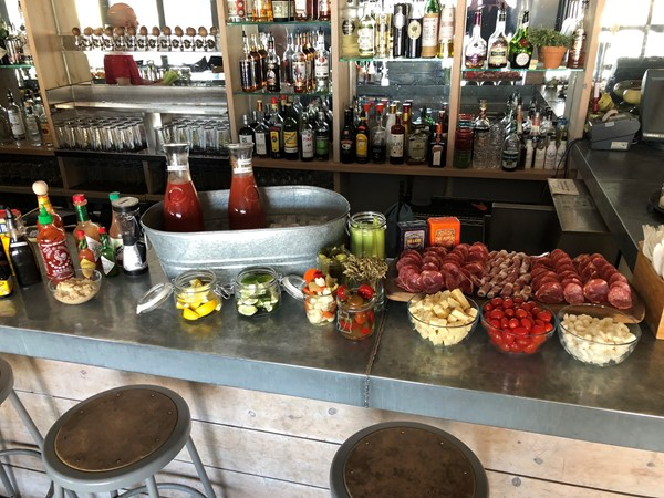 Beautiful Bloody Mary bar at Little Fleet. Sunday brunch with the family in Boardman Neighborhood