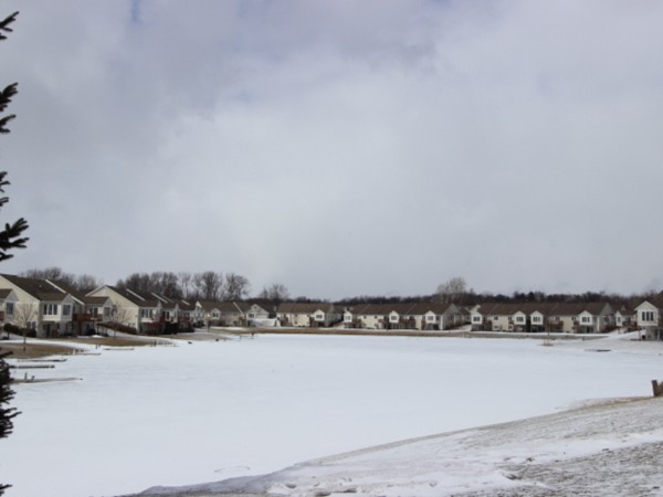 Snow covered pond creates a serene setting for Fairview Shores Community.