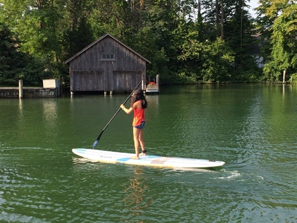 Paddle boarding on the river in Leland