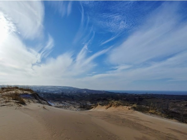 Hike the Sleeping Bear Point dunes and enjoy the rewards of breathtaking views and great workout