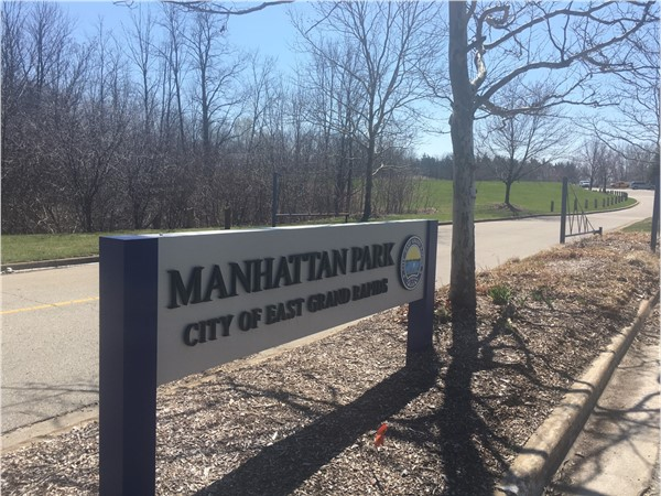 Manhattan Park - volleyball courts, tennis courts, playground, picnic area, charcol grills, benches